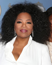 Berry lips complemented Oprah Winfrey's glowing skin tone and flawless complexion at the Black Women in Hollywood Awards Luncheon.