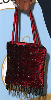 Lorraine Toussaint chose a classic red velvet handbag with black beading while attending the Black Women in Hollywood Luncheon.