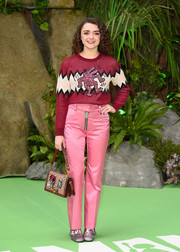 Maisie Williams completed her ensemble with an embellished Coach logo purse.