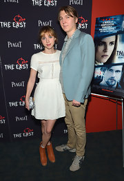 Zoe Kazan contrasted her girly dress with a pair of tough-looking ankle boots at the premiere of 'The East.'