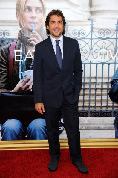 Javier Bardem paired her sleek tie with a navy blue suit.