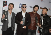 Howard Donald went for a rugged look at the Echo Awards with a brown leather jacket.