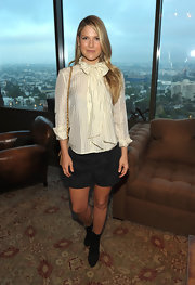 Ali Larter celebrated Rachel Zoe in a pair of dressy shorts and black suede mid-calf boots.