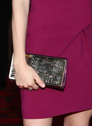 This hard metallic clutch has a beautiful engraving.