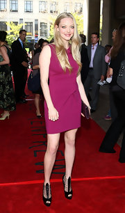Amanda Seyfried paired her hot pink dress with strappy peep toe heels.