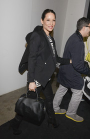 Lucy Liu was spotted at the Edun fashion show carrying an elegant black CHHC leather tote.