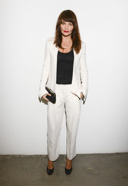 Helena Christensen donned a simple yet stylish white pantsuit for the Edun fashion show.