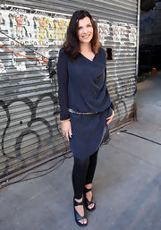 Ali looks casual and comfortable in this cowl neck silk dress.  Adorned with a belt and sexy shoes, we love Ali's unique look.