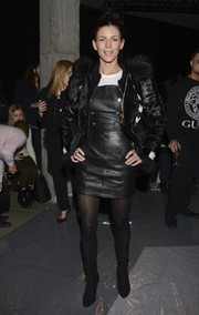Liberty Ross was edgy-glam in a black fur jacket during the Edun fashion show.