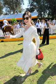 Camilla Belle was spotted at the Veuve Clicquot Polo Classic carrying a woven red bag by Elizabeth and James.