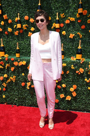 Maggie Gyllenhaal teamed a pink Rodebjer pantsuit with a white crop-top for her Veuve Clicquot Polo Classic look.
