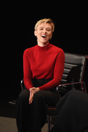 Scarlett Johansson teamed a red turtleneck with black slacks for the Women in the World Summit.