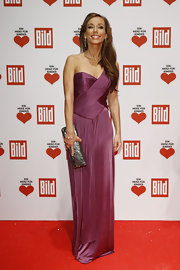 Annemarie Warnkross wore a one-shoulder magenta gown for the Ein Herz Fuer Kinder Charity Gala.