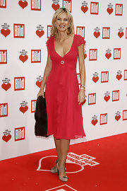 Nina Ruge wore a berry hued chiffon dress for the Ein Herz Fuer Kinder Charity Gala.