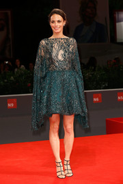 Berenice Bejo made a dramatic entrance in a beaded teal Zuhair Murad Couture dress with batwing sleeves and a sheer bodice during the Venice Film Fest premiere of 'El Clan.'