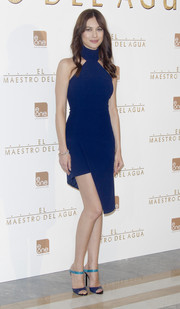 Olga Kurylenko complemented her dress with a very chic pair of Jimmy Choo mules in two shades of blue.