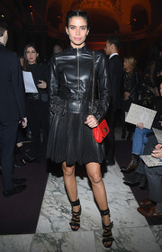 Sara Sampaio punctuated her black look with a studded red shoulder bag, also by Elie Saab.