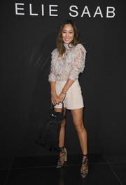 For her arm candy, Aimee Song went hippie with a fringed suede tote.