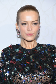 Petra Nemcova pulled her tresses back into a sleek ponytail for the Elie Saab Couture show.