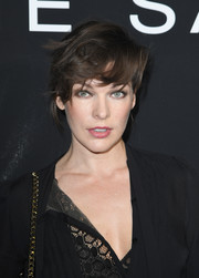 Milla Jovovich attended the Elie Saab Couture show rocking mussed-up hair.