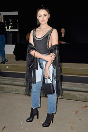 Kristina Bazan injected a Western-chic touch with a fringed black leather jacket.