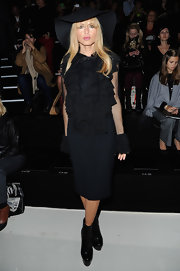 Rachel Zoe stayed sleek in these black patent-leather wedge booties.