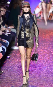 A matching sequin jacket with satin lapels topped off Gigi Hadid's runway look.