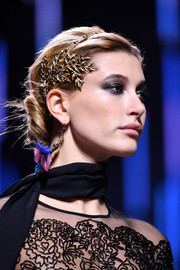 A gold leaf-motif headband polished off Hailey Baldwin's glam look.