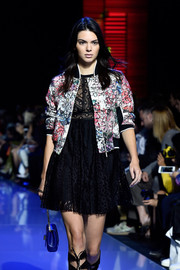 Kendall Jenner showed off one of Elie Saab's colorful jackets during Paris Fashion Week.