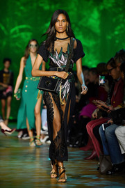 Cindy Bruna flashed some skin in a sheer, embroidered maxi dress on the Elie Saab runway.