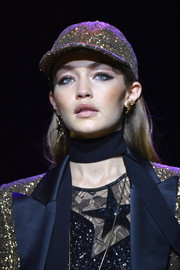 Gigi Hadid rocked a fully sequined baseball cap on the Elie Saab runway.