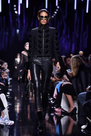 Cindy Bruna was edgy-chic in a velvet-accented cropped jacket while walking the Elie Saab show.