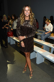 Kelly Bensimon teamed her frock with a pair of animal-print Rockstud pumps.