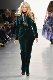 Christie Brinkley walked the Elie Tahari runway wearing a green velvet pantsuit.