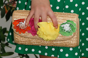 Stefanie Scott held a woven clutch with fabric floral decoration at an Elizabeth Glaser Pediatric AIDS Foundation event.