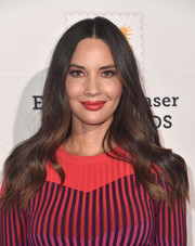 Olivia Munn matched her vibrant outfit with a bright red lip.