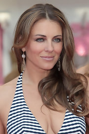 Elizabeth Hurley styled her hair in center part curls for the Beach Boutique opening.