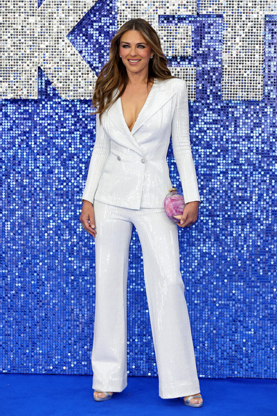 Elizabeth Hurley Printed Clutch [clothing,suit,pantsuit,fashion,formal wear,electric blue,outerwear,photo shoot,pajamas,blazer,red carpet arrivals,liz hurley,rocketman,clothing,suit,fashion,wear,uk,premiere,premiere,elizabeth hurley,rocketman,actor,premiere,celebrity,hawtcelebs,red carpet,livingly media]