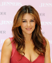 Elizabeth Hurley wore her silky tresses with a soft wave at an Estee Lauder breast cancer awareness event.