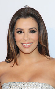 Eva Longoria stuck to her usual center-parted style when she attended the White Diamonds 25th anniversary celebration.