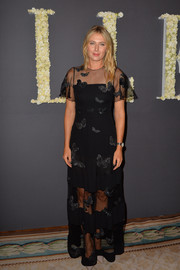 Maria Sharapova was demure and elegant in a butterfly-embroidered sheer-panel gown by Valentino during the Elle anniversary celebration.