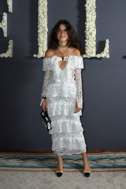 Leandra Medine paired her frilly dress with basic nude and black cap-toe pumps.