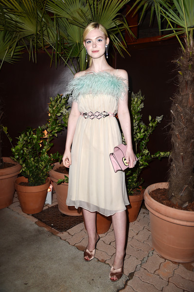 Elle Fanning Leather Clutch [clothing,dress,shoulder,lady,cocktail dress,fashion model,fashion,waist,pink,blond,cannes,france,prada private dinner,cannes film festival,elle fanning,restaurant fred lecailler]
