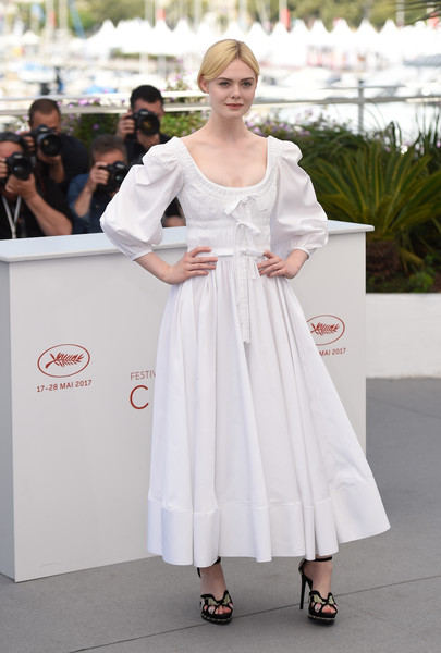 Elle Fanning Maxi Dress [the beguiled photocall,the beguiled,white,clothing,dress,shoulder,fashion,beauty,hairstyle,lady,gown,street fashion,elle fanning,photocall,cannes,france,cannes film festival,palais des festivals]