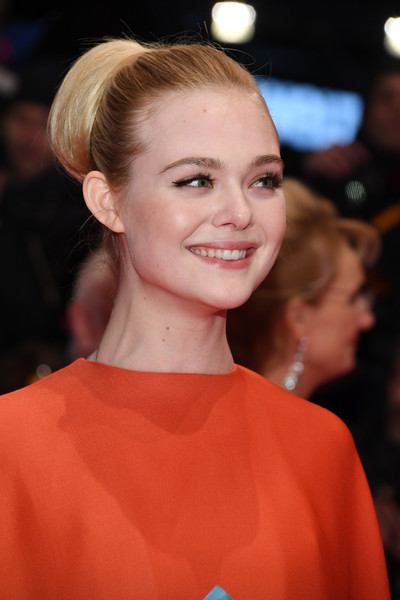 Elle Fanning Retro Updo [hair,face,hairstyle,blond,beauty,eyebrow,lip,chin,premiere,fashion,elle fanning,berlinale palace,berlin,germany,opening ceremony isle of dogs,red carpet,berlinale international film festival,premiere,berlinale international film festival berlin]