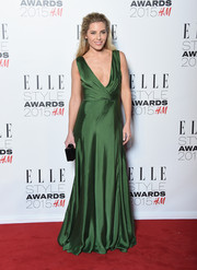 Mollie King was sexy-glam at the Elle Style Awards in a low-cut emerald-green wrap gown by Ralph Lauren.