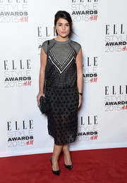 Jessie Ware arrived at the 2015 Elle Style Awards in an interesting dress by Coach made up of a printed T-shirt top and a mesh skirt.