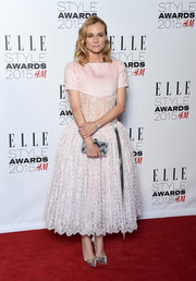 Diane Kruger finished off her ensemble with a silver zigzag-patterned box clutch by Edie Parker.