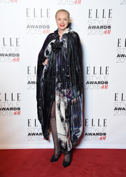 Gwendoline Christie made a grand entrance at the Elle Style Awards in a look-at-me cape by Giles.
