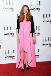 A black cardigan added some coziness to Lily Cole's gown.